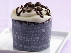 The ever-popular cupcake goes a bit upscale in this almond-flavored version, drizzled with chocolate syrup. Yum!