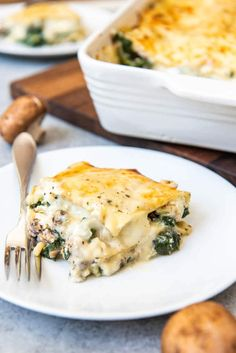 An image of a slice of chicken spinach lasagna made with a white sauce, cheese, and mushrooms.