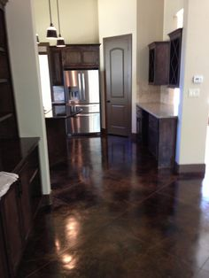 Scored and Stained Concrete Kitchen in Houston, Texas.