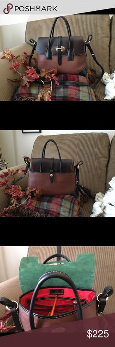 "D&B Verona Satchel w/ strap D&B all leather satchel, New witthout tags, Unused, color is cocoa with brown flap, black on corners and strap,Height:	10"", Depth:	6"" Length 13--1/2"",  outside pocket with snap closure on back of bag, red lining inside with zipper pocket and slip,pocket in backwall and 2 slip,pockets on front wall, handle drop from top of bag is 4-1/2"",  adjustable strap up to 22"", comes with dust cover, from a smoke free home Dooney & Bourke Bags Satchels"