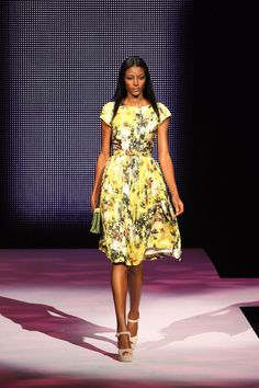 at the Made In Africa by Arise Magazine Spring 2012 show....love the cut of the dress~would need it above the knee.