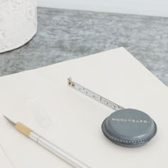 An elegant little tape measure with a soft leather stitched cover in denim blue. Handy for a pocket or handbag. Lovely gift for a knitter or DIY enthusiast.