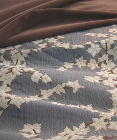 Katsura is a Signature Exclusive contemporary design in upholstery weight. Katsura is a stylized cherry blossom inspired by Japanese kimono design. Pindler Suite 69 in MDC