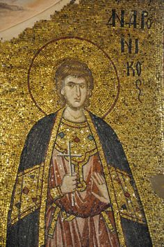 The Chora - full length mosaic of a martyr - 14th century mosaic.  Many of the images from this well preserved 14th century late Byzantine church show both the left and the right side of the cloak with the tablion on the front.  Most of the time the cloak is thrown over the right shoulder obscuring what if anything is there.