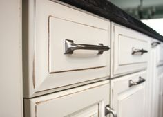 Antique white cabinets with glaze and pulls
