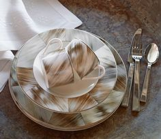 Elegant bone china in a horn-inspired motif, Ralph Lauren Home's Gwyneth tabletop collection