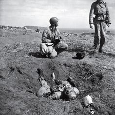 Unpublished. American troops chat near a dead Japanese soldier on Iwo Jima. The degree to which the Japanese were willing to fight to the death, rather than surrender, is summed up in one remarkable statistic: Close to 20,000 Japanese soldiers were killed during the battle; only around 200 were captured.  Read more: http://life.time.com/history/world-war-ii-classic-photos-from-life-magazine/#ixzz2SSjbgFoV