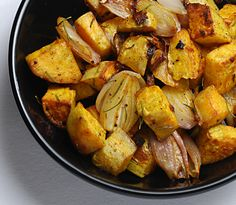 Roasted Sweet Potatoes with Shallots and fresh rosemary, garlic, and cayenne pepper. Sweet/savory side dish with a kick!