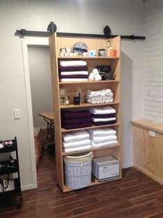 One of our Lovely customers that installed a rolling door. As you can see also u… One of our Lovely customers that installed a rolling door. As you can see also utelised it by adding shelves. Barn Door Decor, Diy Barn Door, Barn Door Hardware, Diy Home Decor, Room Decor, Diy Casa, Diy Door, Home Organization, Woodworking Organization