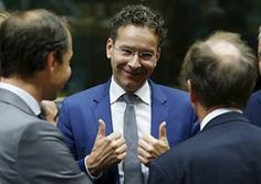 Eurogroup President Dijsselbloem gestures during a euro zone finance ministers meeting in Brussels.  Dutch Finance Minister and Eurogroup President Jeroen Dijsselbloem (C) gestures during a euro zone finance ministers meeting in Brussels, Belgium, July 11, 2015. Greek Prime Minister Alexis Tsipras won backing from lawmakers on Saturday for painful reforms but it remained unclear whether it would be enough to secure a bailout from Germany.