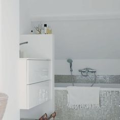 OK SO I LOVE LOVE LOVE the silver gliter accent, would make the toilet seat perfectly and brings some wimsy to what will essentially be black and white bathroom .Light and white bathroom with mosaic tiles from italy