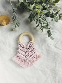 This teether is a new addition that is a soft faded pink colour, made with Niroma Studio cotton fibre. This little baby teether fits perfectly in baby's hands as she explores the natural soft cotton textures on the untreated bpa free wood ring! This is a baby accessory that you Pink Color, Colour, Wooden Teething Ring, Cotton Texture, Baby Teethers, Wood Rings, Different Textures, Mild Soap, Baby Accessories