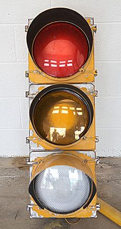 Original American street light or traffic signal.? We've converted it to 240V and added LED's but have left the weathering of the classic yellow paint.  We can mount these on poles as floor lights for bars or the corner of the room.? Alternatively we can offer hanging kits for use as a pendant light fitting in red\/orange\/green or in a more useful warm white or cool white light.