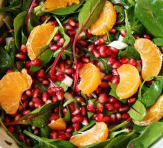 winter salad with baby spinach, fennel, oranges, and pomegranate