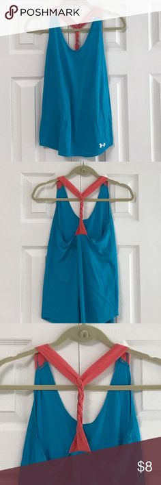 Under Armour workout top 65% polyester 35% rayon machine wash cold. Color is turquoise blue and pink. Top has some pilling from numerous washings but still has good life left.  Gently washed and worn with no rips no stains.  Top has one braided strap in the back. Photo 3. Under Armour Tops Tank Tops