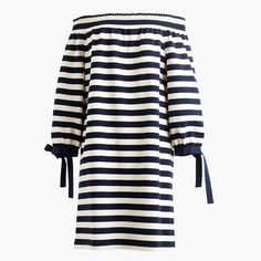 Stripes + off-the-shoulder + ties at the sleeves = the best 30-second outfit on the planet. Falls above knee. Cotton. Machine wash. Import.