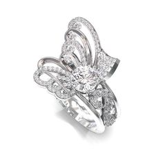 <p>This client wanted to reset her 2ct round brilliant diamond in an unusual butterfly design. Our designers created an initial sketch of the ring and using the computer design software, we illustrated a number of options.</p><p>The finished ring is simply spectacular!</p>
