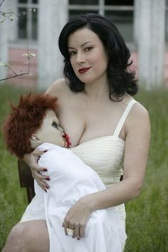 Jennifer Tilly: initiated at her request, on the set of Seed of Chucky, in which she has a great time lampooning the glowing experience of young motherhood, the progeny of Chucky and Tiffany suckling at her breast.