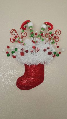 Christmas Stocking Display: Do in decor /color scheme. Leave OUT the elf legs. Replace with a little chalkboard sign with a greeting. Faux candy would be cute.