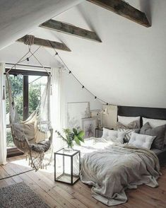 Airy loft, perfect for a staycation. Love the hammock chair, the low bed, the string lights and a patio off the bedroom!!! Love!