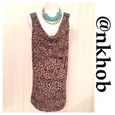 """Leopard Print Tunic/Dress Leopard print sleeveless tunic or dress  with rhinestone straps and drop neckline. Measurements laying flat Bust 20"""", Hips 21"""" Length 32""""  NWOT Dots Tops Tunics"""