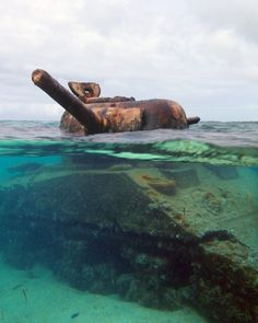 """This Sherman Tank was abandoned in the reef off Garapan beach during the WWII battle of Saipan. It's turret is still trained on the Japanese bunker it was firing at when it got stuck and was abandoned by the crew. Unfortunately this photo had to be taken by my """"pocket"""" camera instead of my good camera, because my 7D is not waterproof. Saw this sitting out in the surf and even not having swimming trunks could stop me from immediately jumping in the water and swimming out to it!..."""