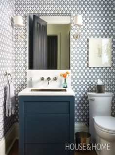 Handsome Powder Room Geometric wallpaper by David Hicks adds bold pattern to this main-floor powder room. Designer Sara Bellamy brought in a tailored navy vanity and simpler fixtures to balance the effect and keep the room from looking too busy. Bathroom Wallpaper Navy, Powder Room Wallpaper, Bad Inspiration, Bathroom Inspiration, Bathroom Ideas, Bathroom Layout, Bathroom Organization, Bath Ideas, Bathroom Remodeling