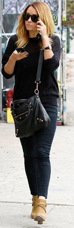 Who made  Lauren Conrad's black watch, sunglasses, black skinny jeans, black handbag, and brown boots that she wore in Los Angeles on November 8, 2012?