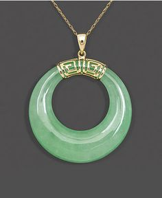 Calm, cool, and collected. This serene pendant features cut-out jade (30mm) highlighted by a Greek key setting crafted from 10k gold. Approximate length: 18 inches. Approximate drop: 1-1/2 inches.   P