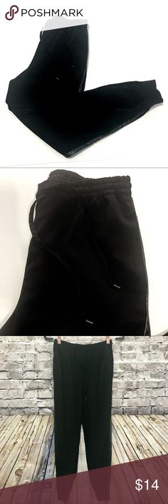 ‼️ANA XS Black Joggers‼️B14 Ana xs Black Joggers Cuffs at ankle, and faux leather stripe detail along the side. Really light and flowey Pants. Has Pockets too!!!! Yay!  100% poly Drawstring waist w elastic. Super chic jogger pants! They come to your natural waistline and would be Perfect w a slightly cropped Plain white tee and sneakers. Perfect for weekends and getting things done, and looking cute! My fav! a.n.a Pants Track Pants & Joggers