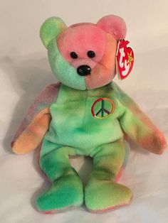 bc9a2068a81 TY Beanie Baby - PEACE the Multi Colored Bear - Pristine with Mint Tags -  PVC Pellets - Retired