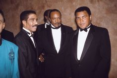 Greats in their respective fields, three time heavyweight champion Muhammad Ali, comedian Richard Pryor, and music producer Quincy Jones in 1991 (James Mitchell/Ebony Collection) Muhammad Ali from the EBONY Archives  Three-time heavyweight champion Muhammad Ali is photographed with fellow boxer Larry Holmes in 1985.  (Isaac Sutton/Ebony Collection) Muhammad Ali from the EBONY Archives  Muhammad Ali stands in front of his Chicago estate, leaning against his Lincoln with p from the EBONY…