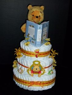 Our reader Debbie shared some photos of an adorable cake she recently made. I LOVE this Winnie the Pooh diaper cake!    The contrast of the yellow and