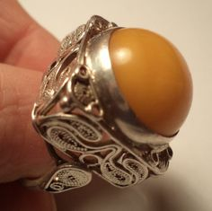From Poland. A silver filigree Baltic amber ring. Rings N Things, Amber Ring, Silver Filigree, Baltic Amber, Signet Ring, Ring Bracelet, Band Rings, Metal Working, Poland