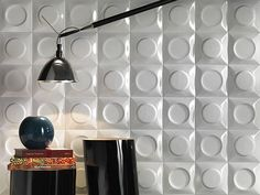 Ceramic, gres and porcelain wall tile collection. The tile modules feature both concave and convex shapes and they can be used to create a visually challenging tridimensional wall design. The modules are only available in either black or white. The simplicity of the color and the neutral shades let the shape become the center of attention. Since the goal was to create a tridimensional design where the texture and shape are the most important elements, the color would just have been too much.