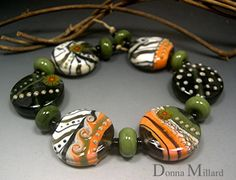 Snake Eye, handmade glass beads by me.  In my etsy, click me!