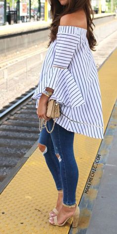 Love the hi-low perfect-with-jeans look of the great white on navy striped ruffle blouse. The shoes kick it all the way home.