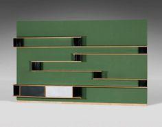 Charlotte PERRIAND Importante enfilade bibliothèque en bois et plots métalliques