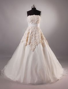 Here is a vintage looking two toned lace wedding gown that has a ribbon sash belt. This strapless bridal gown design has a ball gown skirt. We have many more designer wedding dresses in the collection that can all be customized!