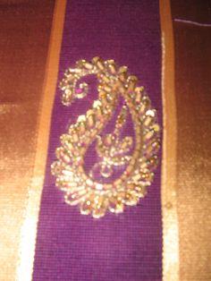 Embroidered paisley on a sari pallu.