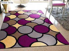 Alfombra Frisse 14 Sualsa, con un elegante diseño geométrico a base de formas circulares de distintos colores.