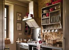 Old-fashioned dish racks and cup hooks are a convenient and stylish idea to steal from vintage kitchens.