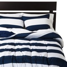 Create a beautiful room with the bold, crisp stripes of the Room Essentials Rugby Stripe Comforter. This striped comforter adds striking contrast to any decor scheme. You can add bright yellow, orange or red pillows and accessories to accent the classic look of this comforter. Made of 100% easy-care polyester, this quilted bed topper will look great from season to season. Just toss it in the wash with our other bedding to freshen when needed. Add other items from the Room Essentials Rugby…