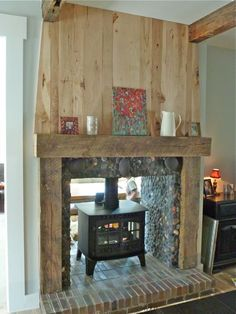 two sided wood burning stove from dining room side brick base and wooden frame Two Sided Fireplace, Home Fireplace, Fireplace Design, Fireplaces, Fireplace Ideas, Wood Burner, The Ranch, My Living Room, Log Homes