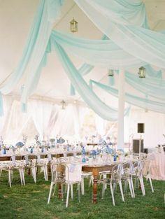Light blue drapes and pretty blue flowers / http://www.deerpearlflowers.com/wedding-tent-decoration-ideas/