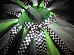 """Kawasaki Monster Energy tutu skirt.  this has black, white and Monster Energy green tulle on black and white checkered """"flag"""" ribbon for the waist.  The checkered ribbon is also tied throughout. as shown 0-6months $20.00"""