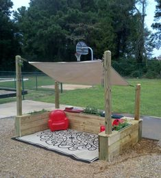 A couple of chairs, some wind chimes, a drop cloth and some garden boxes provides an outside place for toddlers to renew and refresh at Sunshine House 15 in Mauldin, SC.
