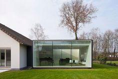 Belgian studio Cocoon Architecten started from an existing farmhouse in Genk, Belgium, and constructed a modern oasis of comfort prepared to take on a new lifestyle. The Framework House.