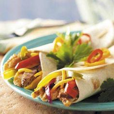 Mixed Grill Fajitas Recipe -Everyone loves these warm tortillas wrapped around the mixed grill, veggies and cheese. The recipe's an original with me, and through trial, I found you cannot make an error!—Karen Haen, Sturgeon Bay, Wisconsin