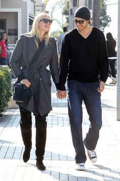 Maria Sharapova Sasha Vujacic Photos - Newly engaged couple Maria Sharapova and Los Angeles Laker Sasha Vujacic look very much ready for marriage as they walk hand in hand while out for lunch. Sharapova could be seen wearing a rather large engagement ring while out and about with her future husband. - Maria Sharapova and Sasha Vujacic Take a Walk